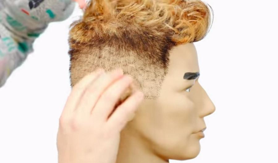 Натуральные короткие волосы на висках выделяются на фоне макушки, и в то же время переход к окрашенным волосам выглядит плавным (скрин из видео TheSalonGuy на YouTube)