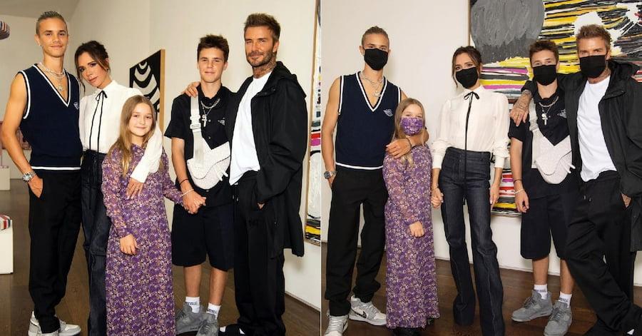 Так выглядит настоящий family look. Только платье и маска Харпер ярким пятном выделяются на фоне монохромных образов родителей и братьев